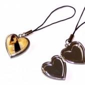 Gintaru dekoruota atidaroma širdelė, pakabutis